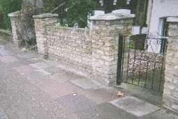 Front wall and gate in inner city street